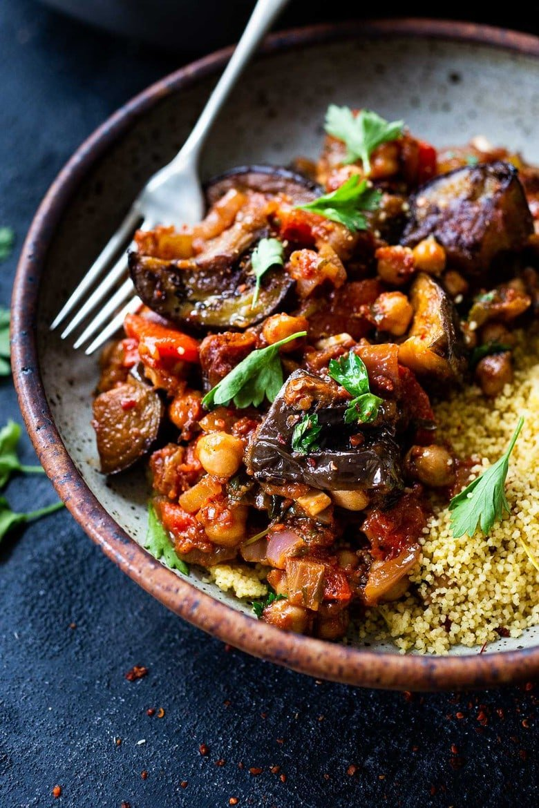 A simple delicious Tagine Recipe with Eggplant and Chickpeas infused with Moroccan spices, served over cinnamon-scented couscous. This flavorful Eggplant Chickpea Stew is vegan and gluten-free.