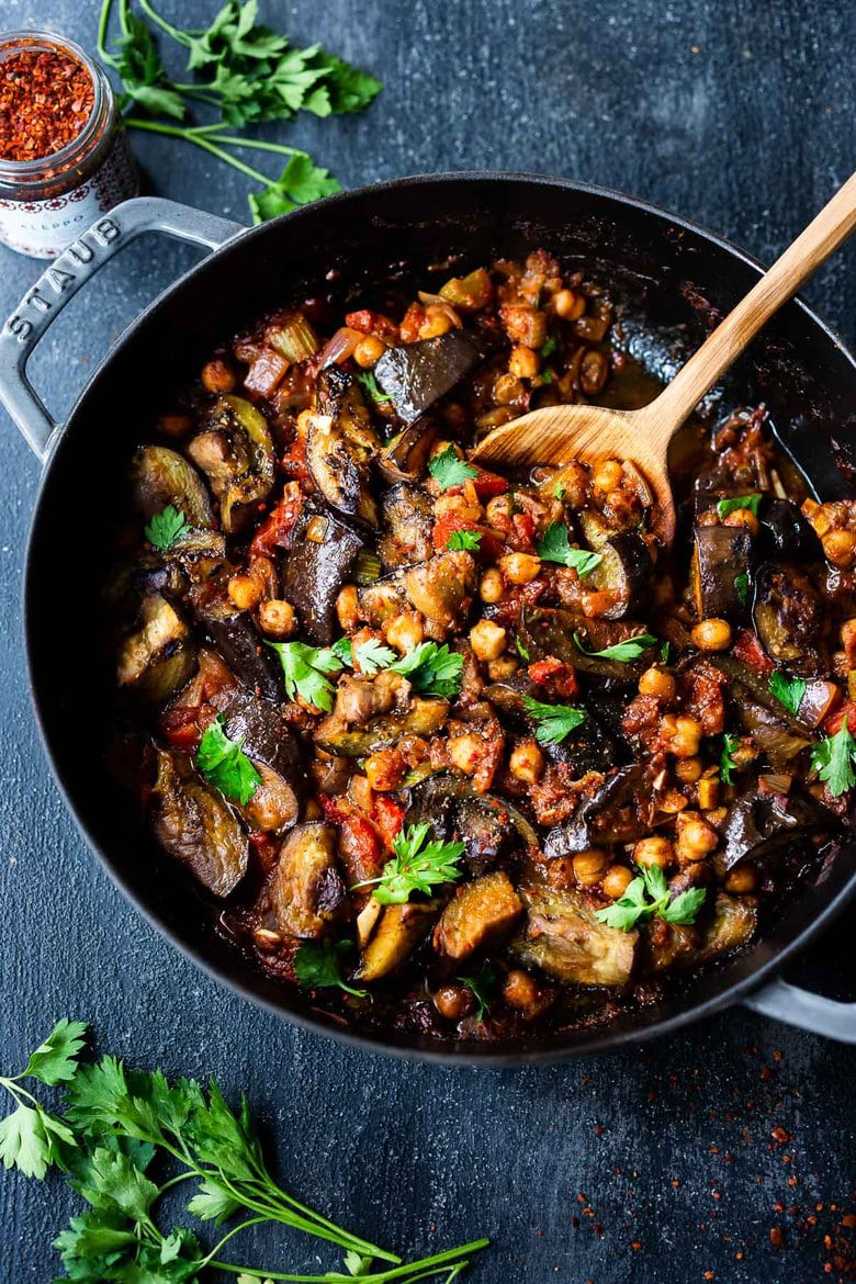 Delicious, Healthy Tagine Recipe with Eggplant and Chickpeas- seasoned with Moroccan spices and served over couscous. A simple plant-based dinner recipe! #tagine