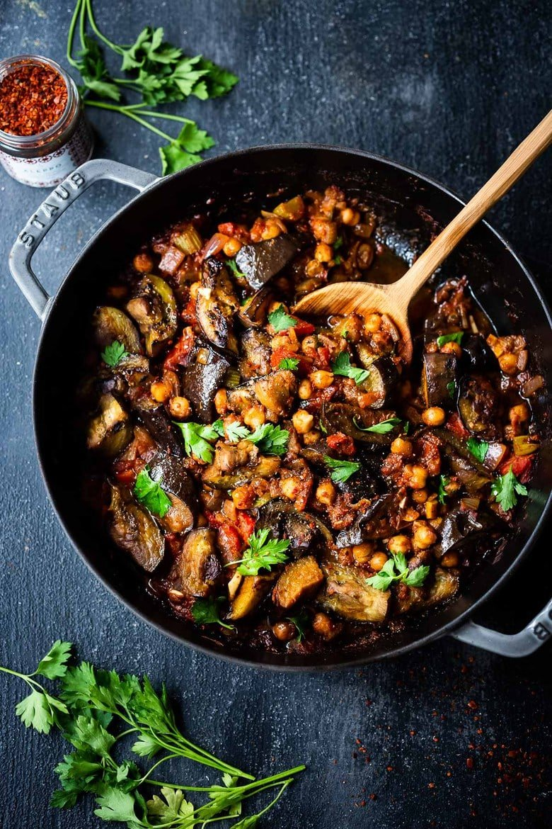 Flavorful Tagine Recipe with Eggplant and Chickpeas- seasoned with Moroccan spices and served over couscous. A simple plant-based dinner recipe!