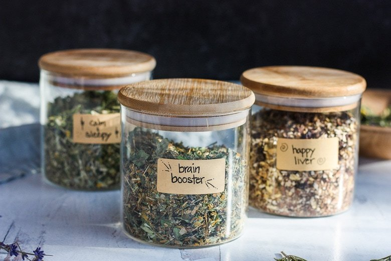 The Benefits of drinking Herbal Tea plus 3 Herbal Tea Recipes ( Brain Booster Tea, Happy Liver Tea and Calm and Sleepy Tea) you can make at home for sleep, brain function and liver support. Easy and adaptable, these herbal tea blends are nutritive and soothing.#herbaltea #tea #herbtea