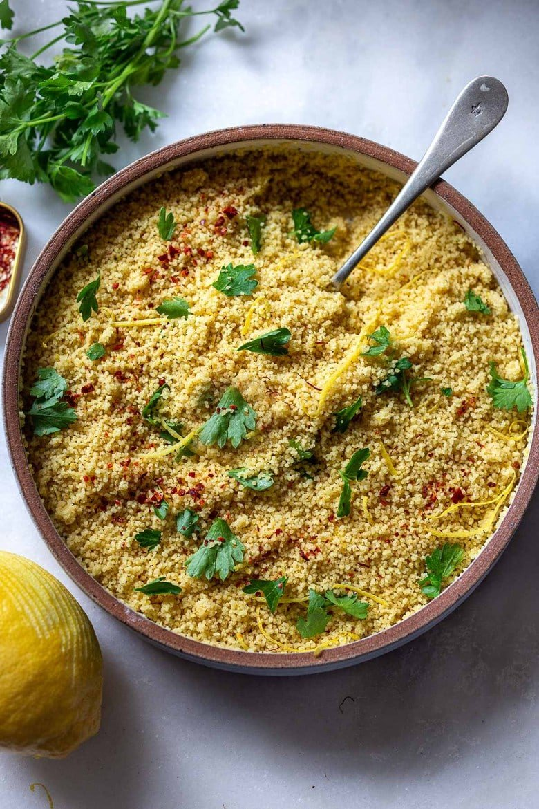 How to cook Couscous - a quick and easy recipe with three different flavor variations! Couscous is a North African (or Berber) sidedish of tiny steamed balls of crushed durum wheat that is traditionally served with flavorful tagines and stews. #couscous