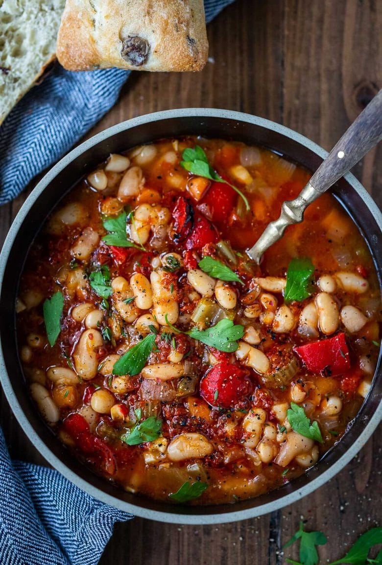 Smoky Tomato White Bean Soup you can make in your Instant Pot or on the stovetop using dry beans. Smoked paprika and optional Harissa paste give it a delicious flavor that will have you coming back for seconds.  Low in calories, high in fiber, this soup is vegan and gluten-free.
