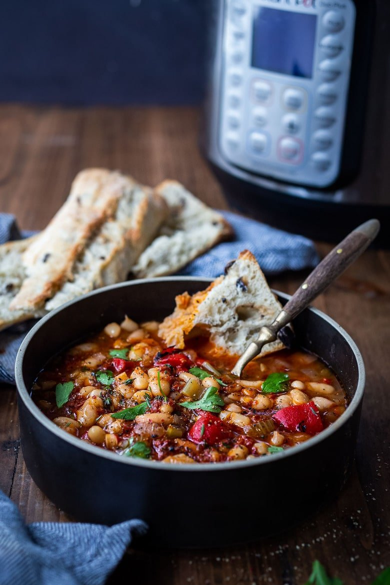 Smoky Tomato White Bean Soup, you can make in your Instant Pot or on the stovetop using dry beans. Smoked paprika and optional Harissa paste give it a delicious flavor that will have you coming back for seconds. Low in calories, high in fiber, this soup is vegan and gluten-free.