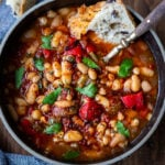 Smoky Tomato White Bean Soup with roasted peppers and optional harissa oil, made with dry beans in an instant pot or on the stove top. Vegan and gluten free.
