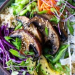 Miso Mushroom Bowl with brown rice, avocado, cabbage, carrots, daikon, edamame and a Miso Ginger Dressing. Vegan and Gluten free.