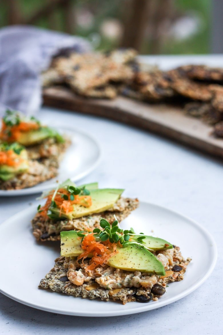 Light and crisp, these Rustic Seed Crackers are keto, gluten-free and vegan.  This recipe is incredibly easy, flexible, adaptable and full of toasty rich flavor.  They are the perfect snack by themselves, and pair with most toppings. #ketocrackers #keto #crackers #seededcrakers #seedcrackers