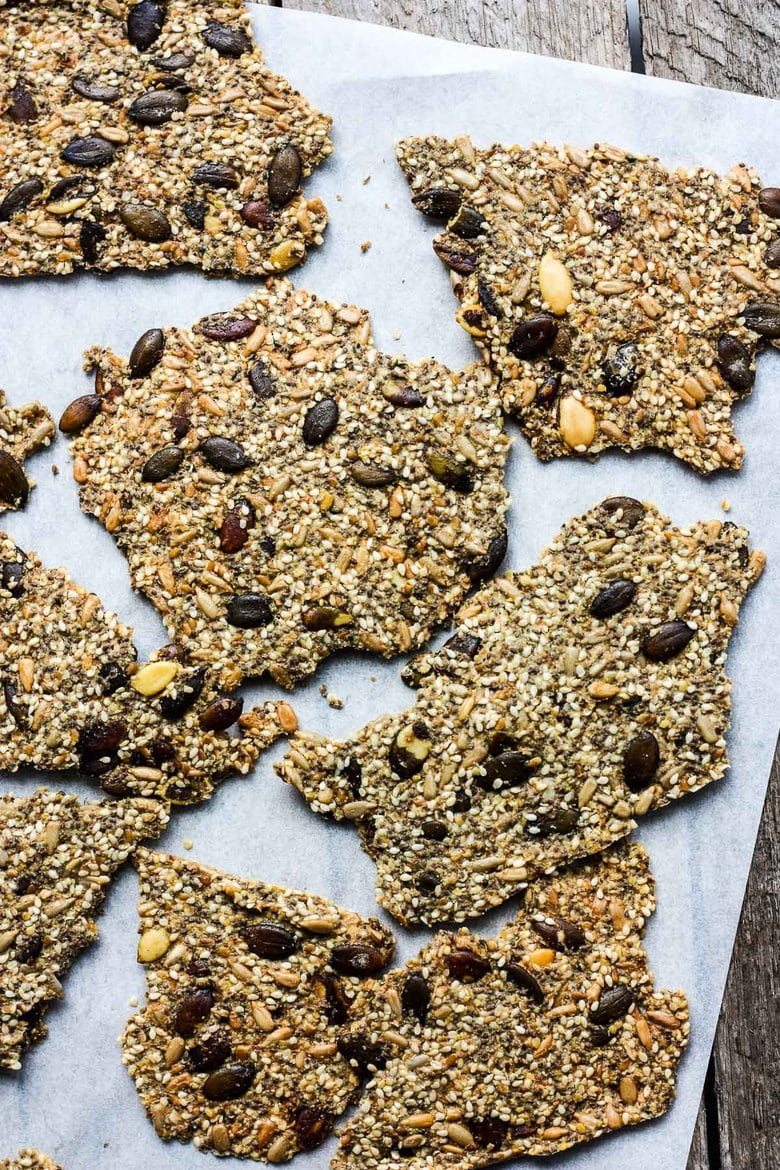 Light and crisp, these Rustic Seed Crackers are keto, gluten-free and vegan.  This recipe is incredibly easy, flexible, adaptable and full of toasty rich flavor.  They are the perfect snack by themselves, and pair with most toppings.