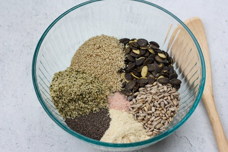 how to make the seed crackers- add everything to a bowl.