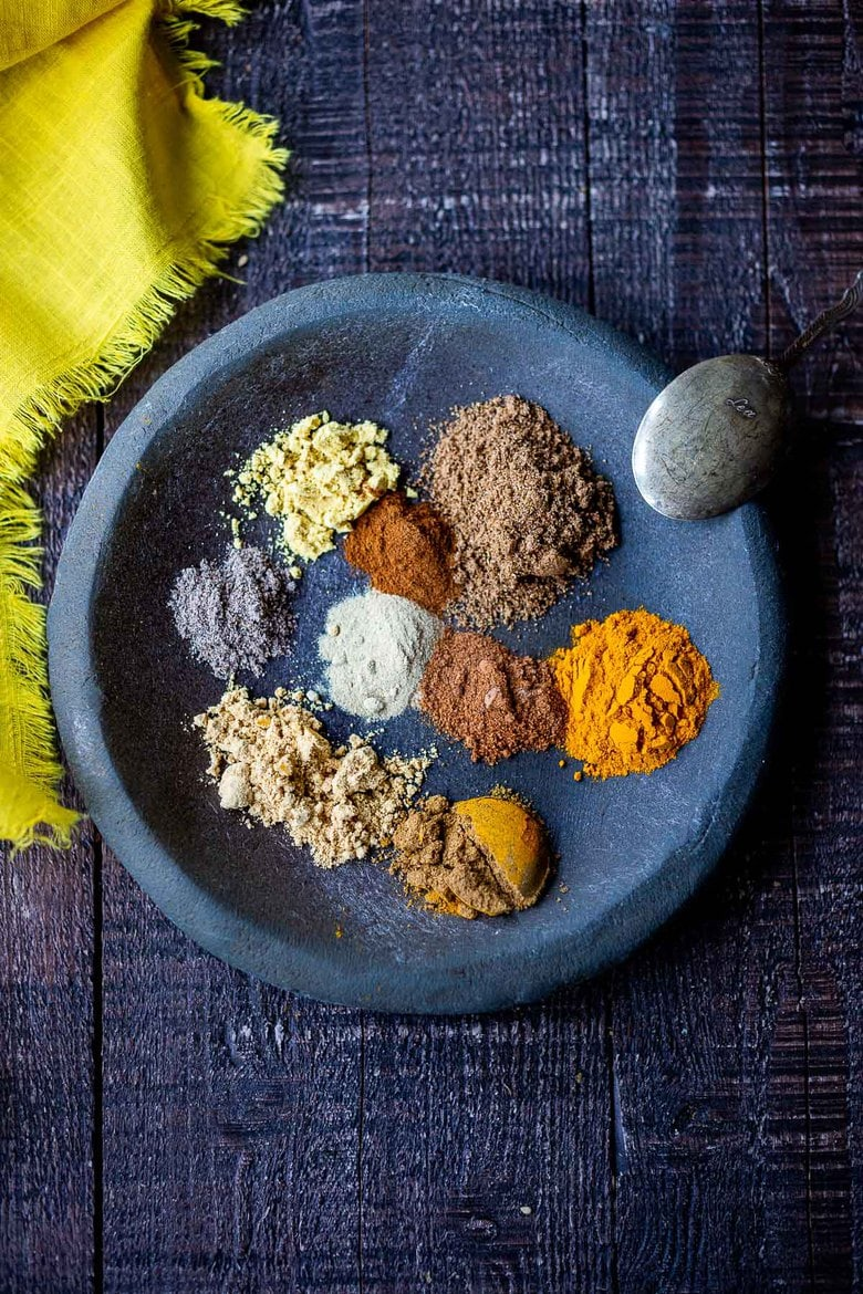 How to make homemade Yellow Curry Powder using spices you already have in your spice drawer. This mild Indian version is simple and easy and can be made with whole spices or ground spices. #currypowder #yellowcurrypowder #curry