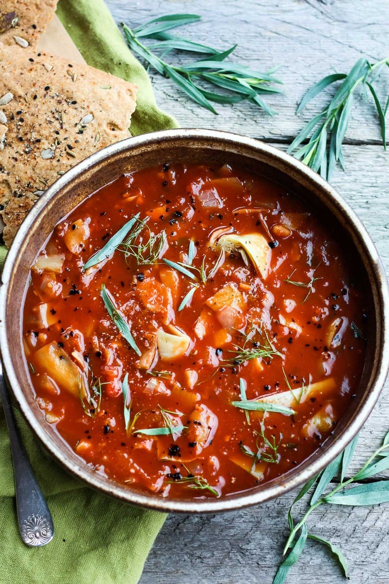An easy vegan recipe for Tomato Artichoke Soup using pantry ingredients. Perfect for when you're in the mood for a dynamic tomato soup with very little hands-on effort. Ready in 20 minutes!
