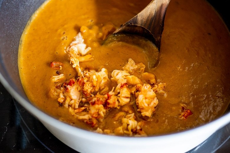 Blend the soup until creamy, then add the lobster.