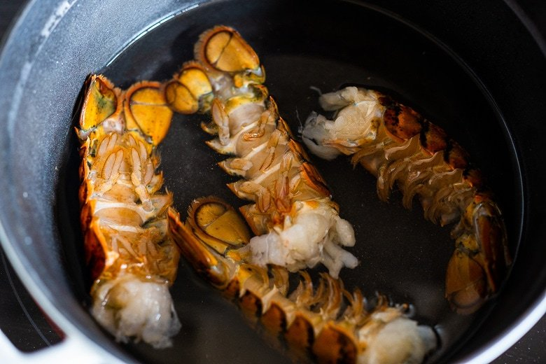 simmer 1 ¼ lbs of lobster tails in salted water.