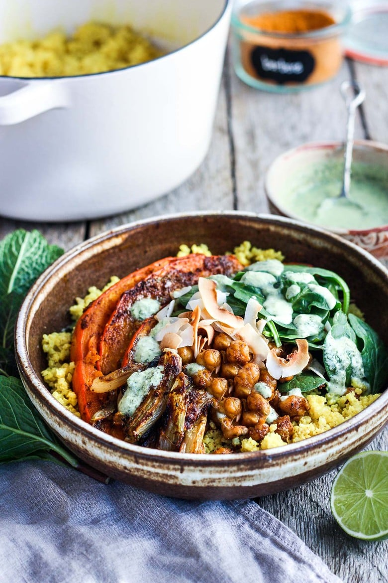 Coconut Millet Bowl with Berbere-Spiced Kabocha Squash, chickpeas, shallots, and spinach drizzled with coconut lime mint sauce. A vegan, plant-based meal, full of vibrant flavor and spice. #millet #veganbowl #buddhabowl #berbere