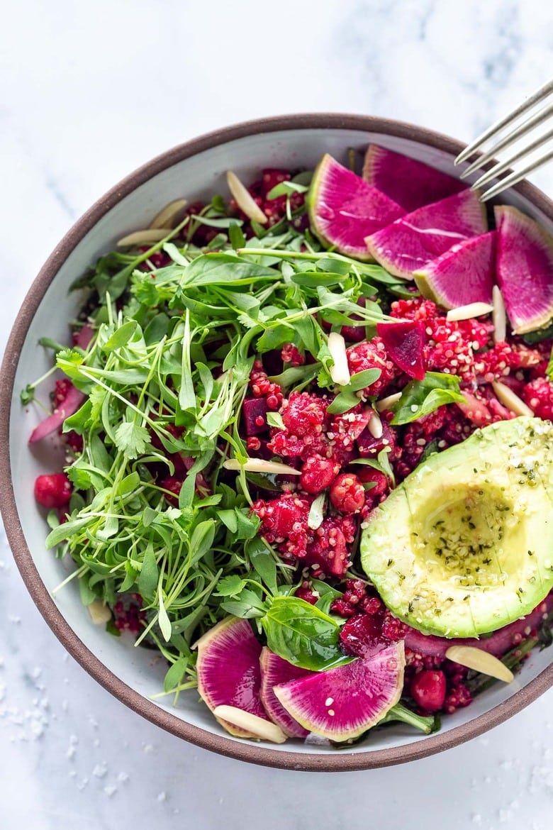 Brighten up your day with this Winter Bliss Bowl! A simple vegan bowl made with beets, quinoa, avocado and chickpeas-that can be made in under 30 minutes! Great for meal-prepping and guaranteed to lift your spirits! #bowl #buddhabowl #veganbowl #