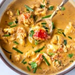 This Lobster Bisque Recipe is kept simple and easy with quick homemade lobster stock, big bites of lobster tail, and a creamy luscious bisque thickened with sweet potatoes. For Extra decadence the lobster is sautéed in browned butter. #lobsterbisque #lobster