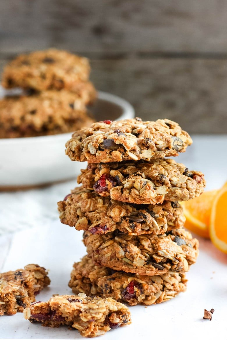 These healthy Breakfast Cookies can be made in under 30 minutes! They are chockfull of flavor andsustenance -filled with oats, seeds, spices and dried fruit they are vegan and deliciously addicting! Perfect for breakfast on the go. #breakfastcookie