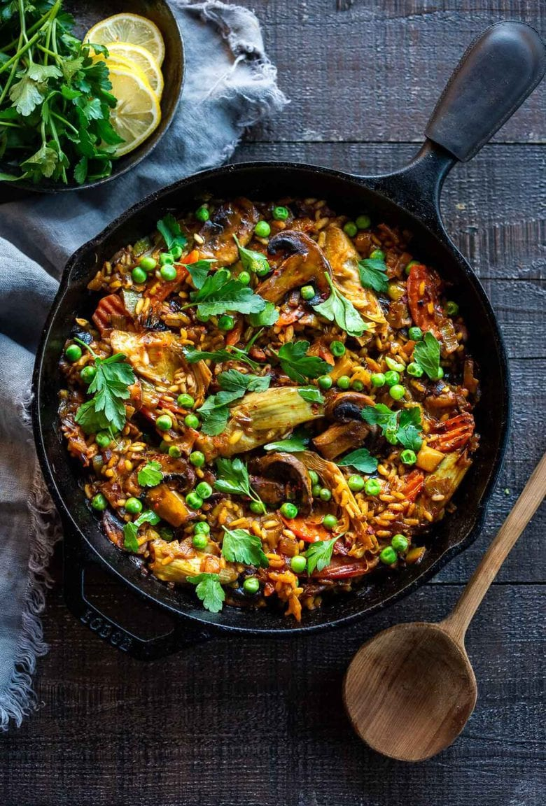 How to make authentic Vegetable Paella like they do in Spain! A simple, easy, vegetarian dinner recipe that comes together in under an hour! Vegetarian, vegan and gluten-free!