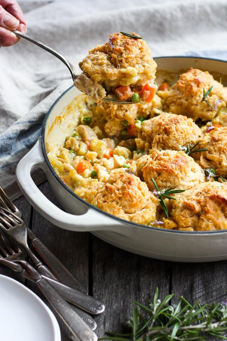 How to make Chicken Pot Pie with quick and easy biscuit crust, tender veggies, fresh herbs, in a creamy wine sauce.