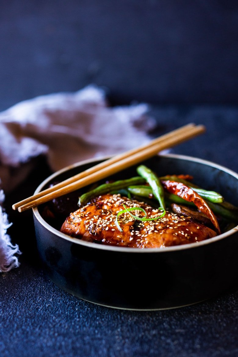 A tasty recipe for Sheet-Pan Szechuan Salmon with Scallion Green Beans baked in the oven that can be made in 30 minutes. A delicious healthy weeknight dinner! #szechuan #salmon #sheetpandinner