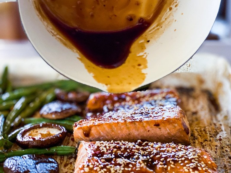 pour the thickened Szechuan sauce over the cooked salmon