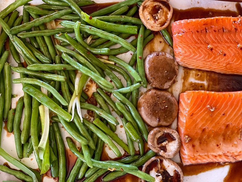 place the veggies and salmon on a sheet pan