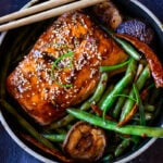 A tasty recipe for Szechuan Salmon with Scallion Green Beans baked in the oven that can be made in 30 minutes. A delicious healthy weeknight dinner! #szechuan #salmon