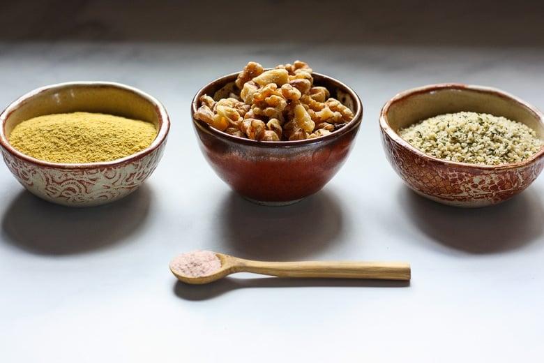 ingredients in vegan parmesan sprinkle - hemp, walnuts and nutritional yeast