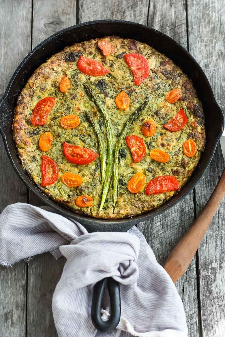 Springy Vegan Frittata stocked up with fresh herbs, leeks and asparagus and a flavorful creamy chickpea flour filling. #frittata #veganbreakfast #veganfrittata
