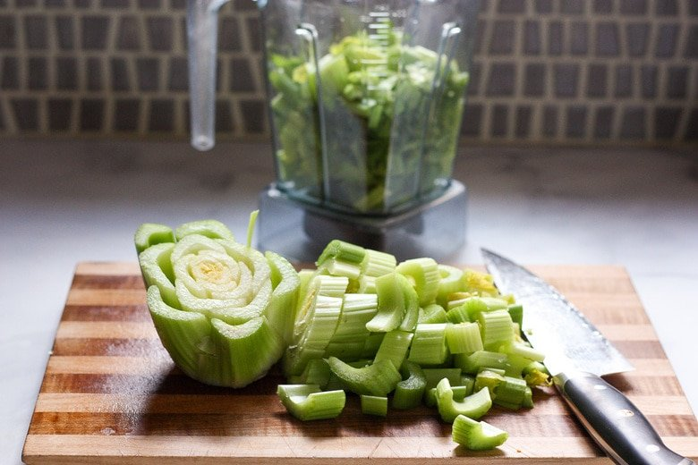 celery being chopped for the blender to make celery juice
