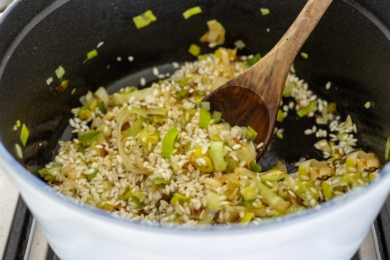 start the risotto-saute the leeks and garlic