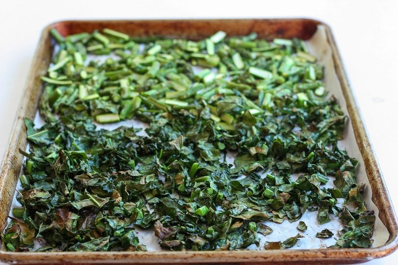 roasted, lightly charred asparagus and kale on a sheet pan