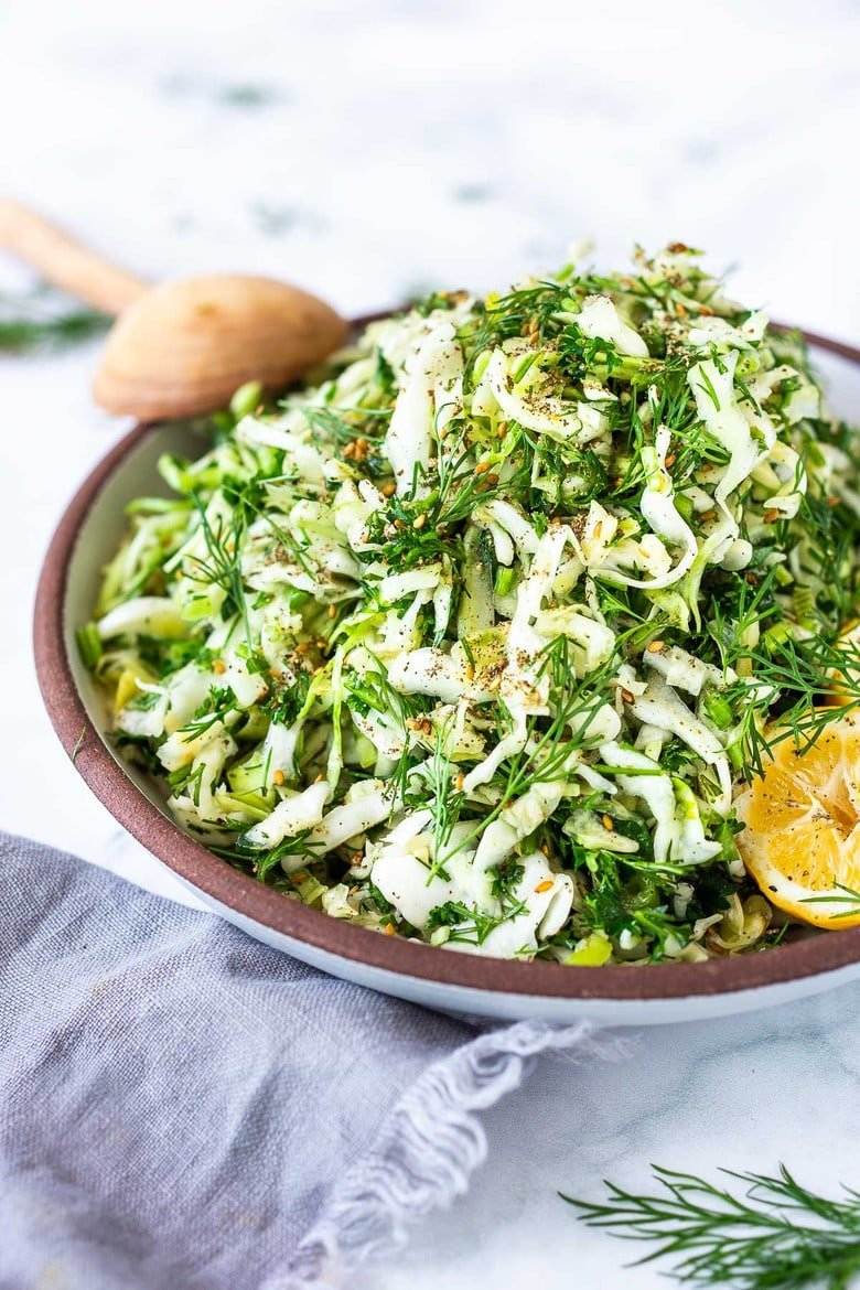 Simple Lebanese Slaw (aka Salatet Malfouf) made with crunchy cabbage, fresh herbs, lemon, garlic and scallions. A delicious vegan side to serve with your Middle Eastern feast.#slaw