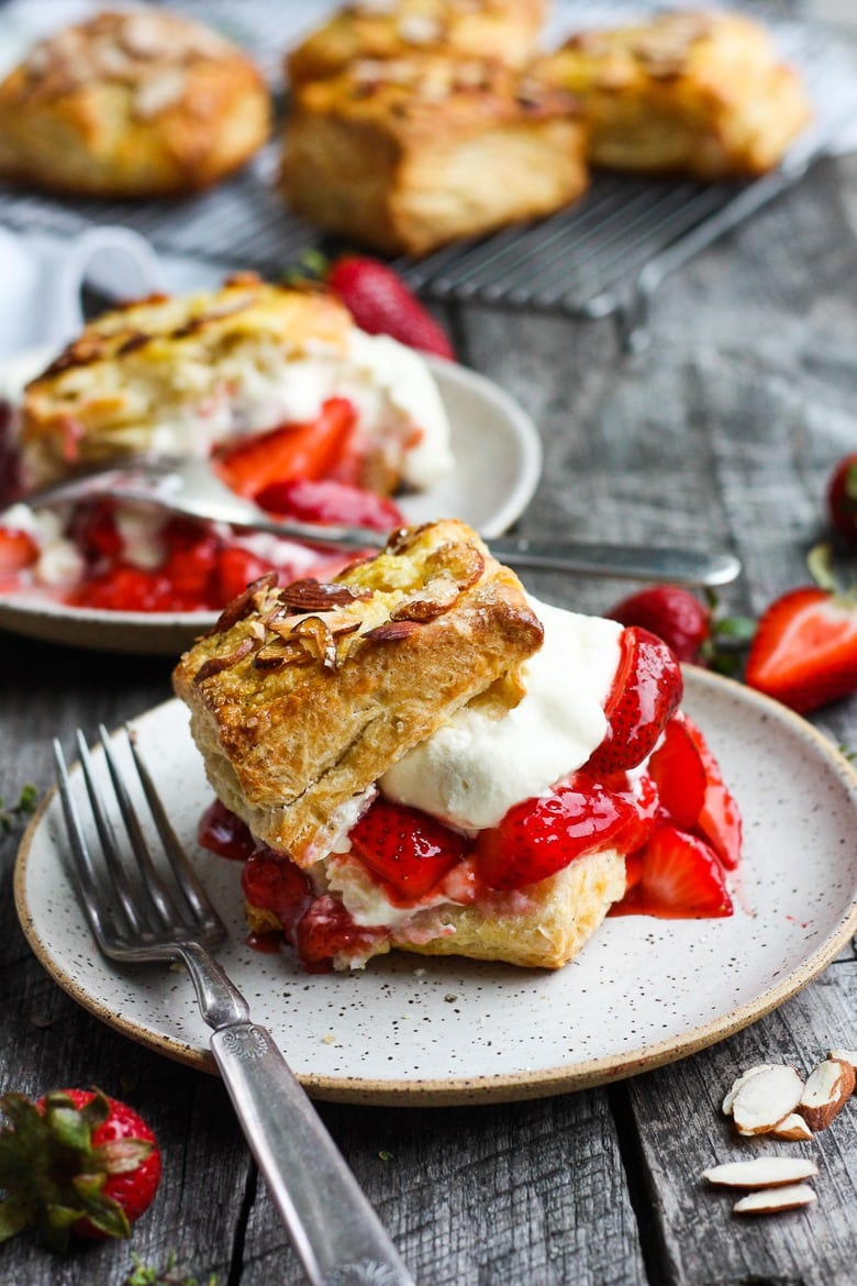 Homemade Strawberry Shortcake from Scratch with golden, flakey biscuits, jammy strawberry sauce, and yogurt whip cream.  The perfect American dessert with a twist.  This elevated version of the classic is subtly sweet and deeply satisfying. #strawberryshortcake