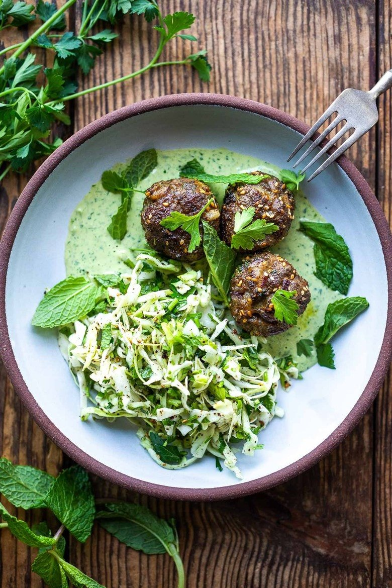 Zaatar Meatballs with Green Tahini Sauce can be made with ground turkey, chicken, lamb or beef. A quick, low-carb meal that is full of flavor. #meatballs #zaatar
