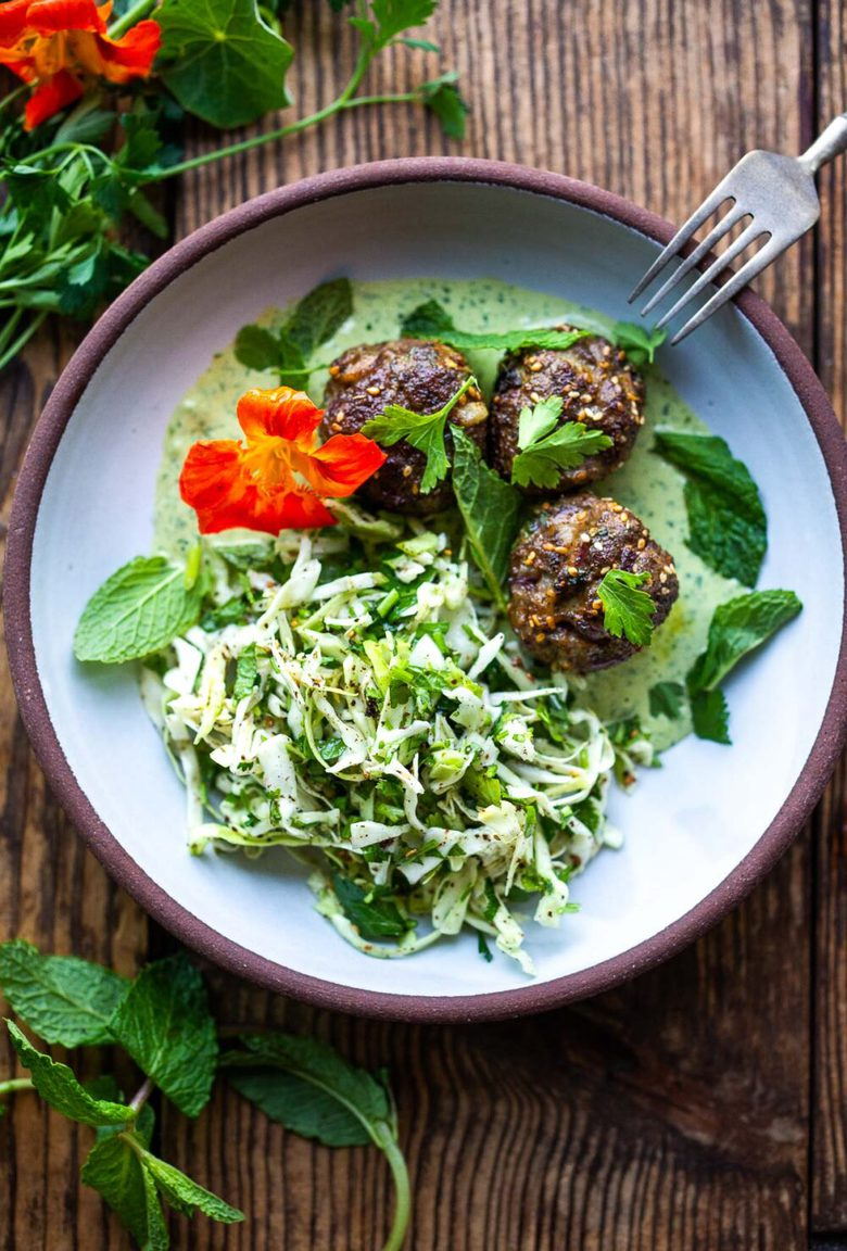 Zaatar Meatballs with Green Tahini Sauce can be made with ground turkey, chicken, lamb or beef. A quick, low carb meal that is full of flavor. #meatballs #zaatar