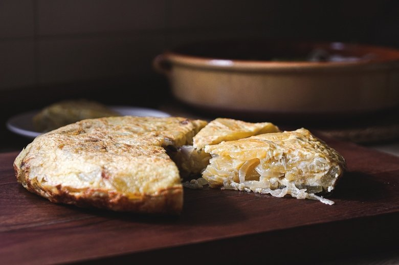 This classic Spanish Potato Tortilla (aka Tortilla de Patatas or Torta Espanola) is a lightened-up version made with thinly sliced potatoes, caramelized onions, eggs, and olive oil that can be served for tapas, breakfast, lunch or dinner. #spanishtortilla #tortilladepatatas #tortaespanola