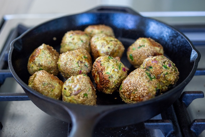 turkey meatballs in a skillet cooking