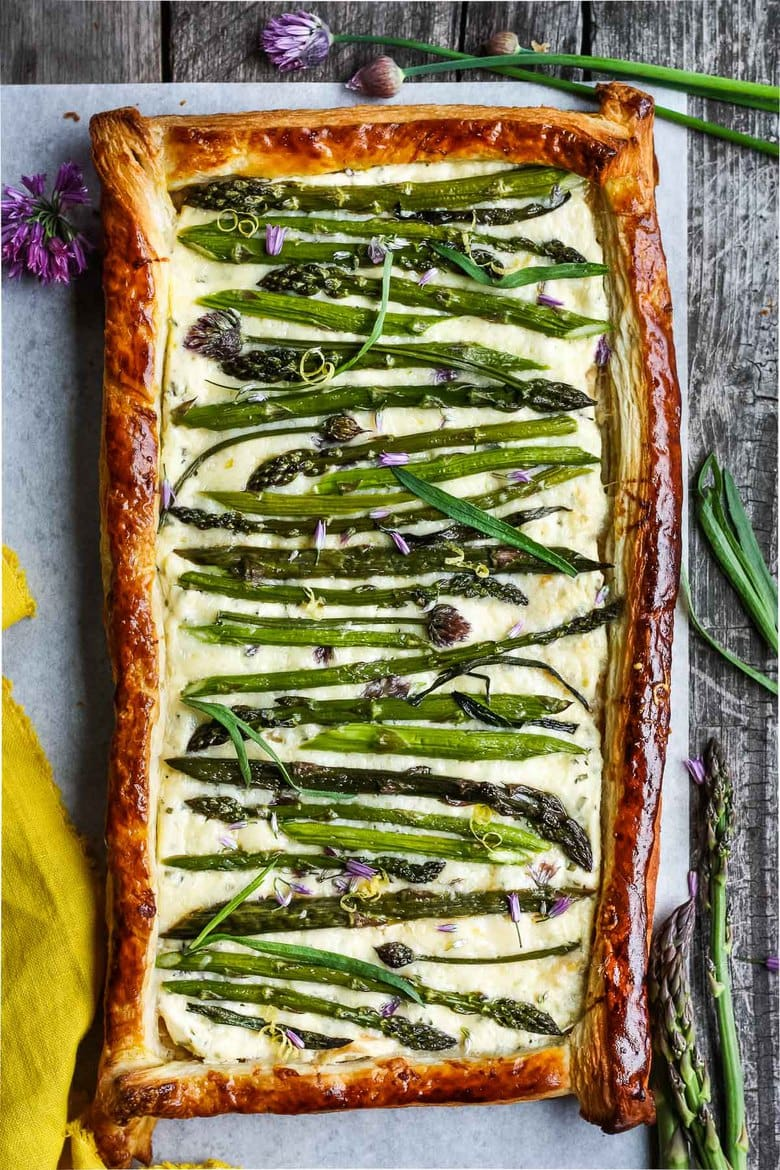 Asparagus Tart with tarragon, chives and gruyere in a flakey puff pastry crust- a simple elegant dish, perfect for a special occasion. Under 30 minutes of hands-on time!
