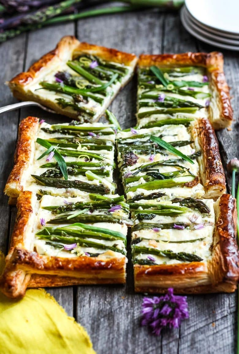 Asparagus Tart with tarragon, chives and gruyere in a flakey puff pastry crust- a simple elegant dish, perfect for a special occasion.  Under 30 minutes of hands-on time! #asparagustart