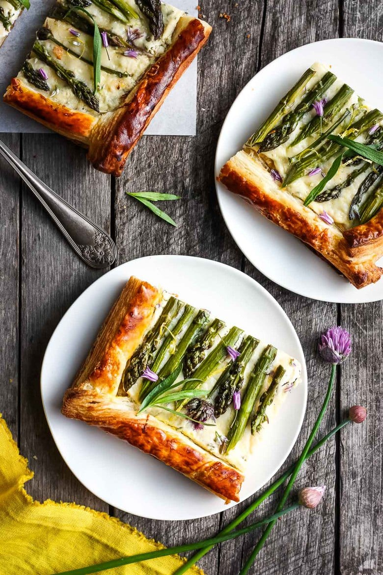 Asparagus Tart with tarragon, chives and gruyere in a flakey puff pastry crust- a simple elegant dish, perfect for a special occasion. Under 30 minutes of hands-on time! #puffpastrytart #asparagustart #asparagus
