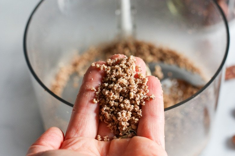 Processed pecans to a coarse meal.