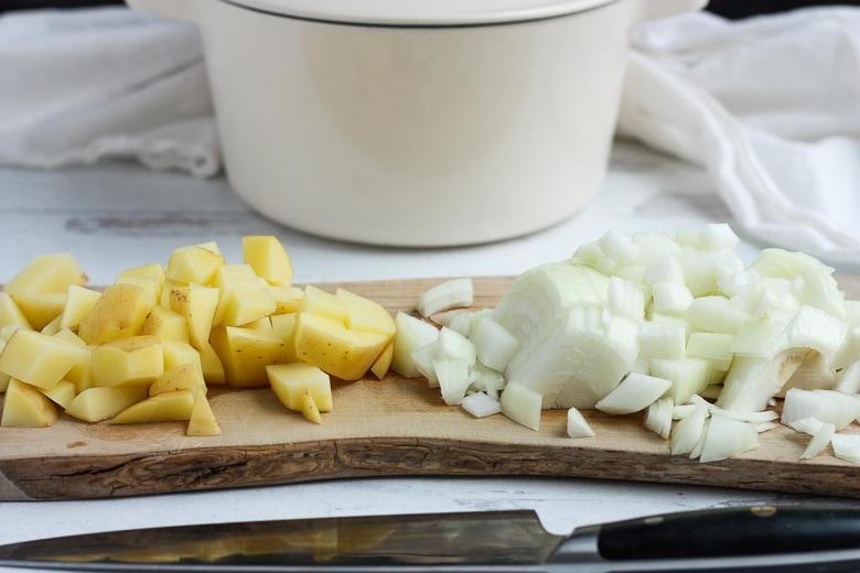 chopping potatoes and onion