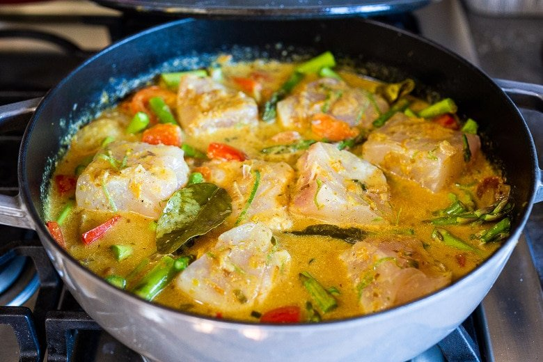 add the fish, and let it simmer gently