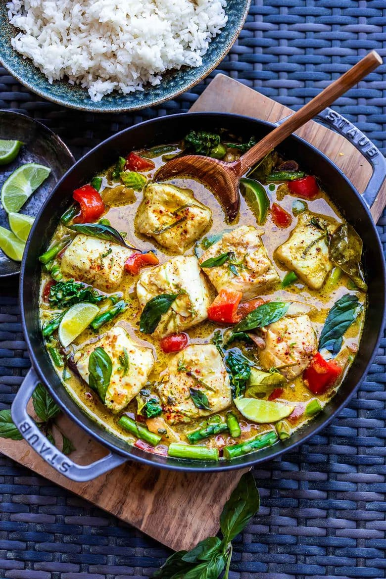 This recipe for Thai Fish Curry with Coconut Milk is brimming with seasonal veggies and bursting with delicious Thai flavors. A quick and easy dinner, perfect for both weeknights and special occasions. #thaifishcurry