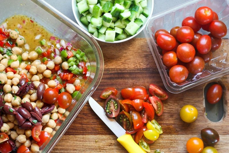 Add veggies to the dressing as you chop them