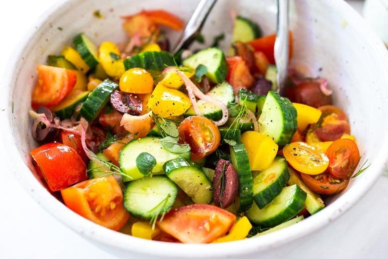 toss the Greek Salad ingredients to combine
