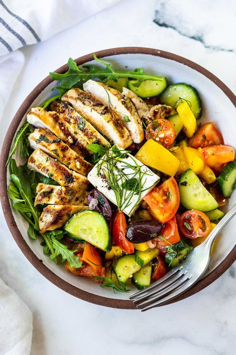 A simple, easy recipe for the juiciest, most flavorful Grilled Lemon Herb Chicken served over a classic Greek Salad! Delicious and easy!