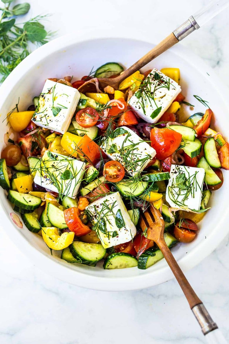 This Greek Salad is everything you want in a summer salad- refreshing, vibrant, flavorful and healthy. Simple ingredients and can be made in 20 mins! #greeksalad
