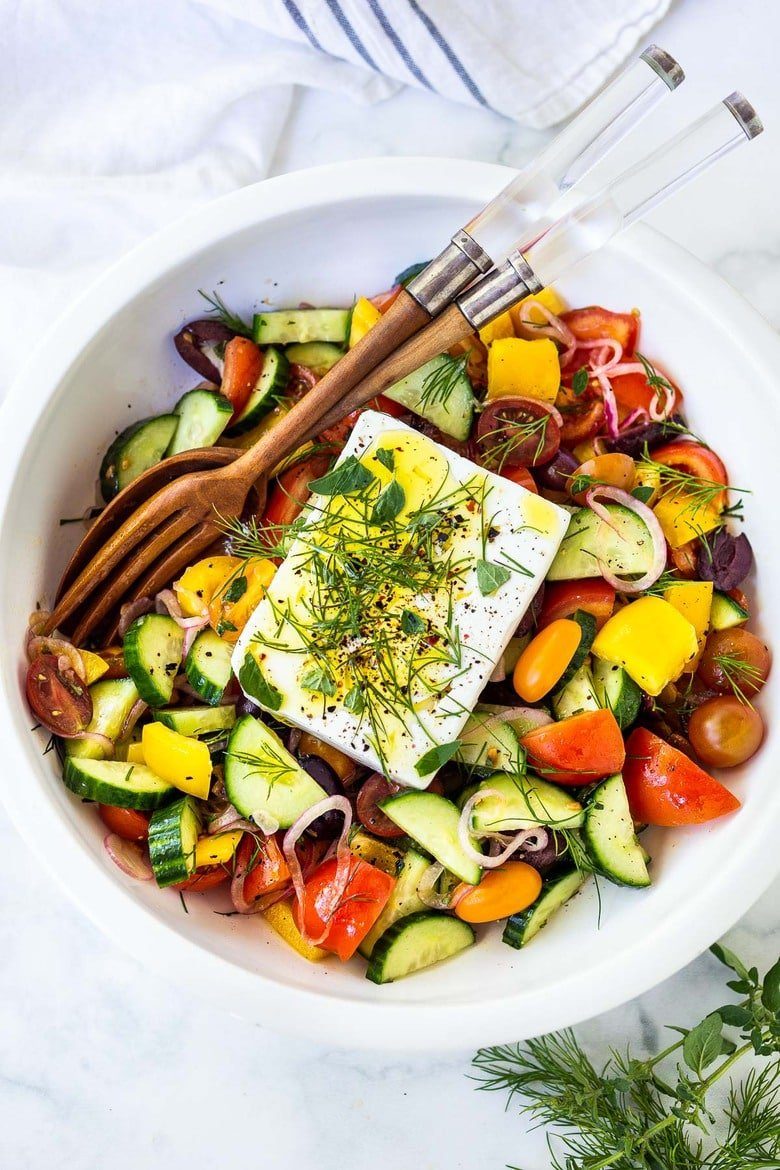 This classic Greek Salad is bursting with summertime flavor! Made with vine-ripened tomatoes, cucumbers, bell pepper, kalamata olives and sheep's milk feta, this salad highlights the best of summer produce and lets the vegetables shine!