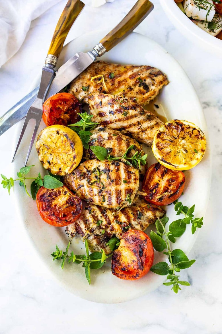 A simple, easy recipe for the juiciest, most flavorful Grilled Lemon Herb Chicken that turns out perfect every time. Make this with skinless chicken breast or chicken thighs to pair with salads or veggies.#grilledchickenbreast #grilledchicken